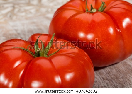 Two fresh, organic, large and juicy red tomatoes