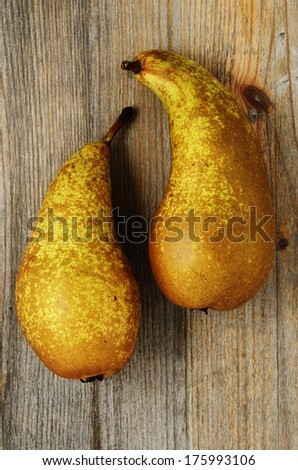 two fresh pears on a wooden board