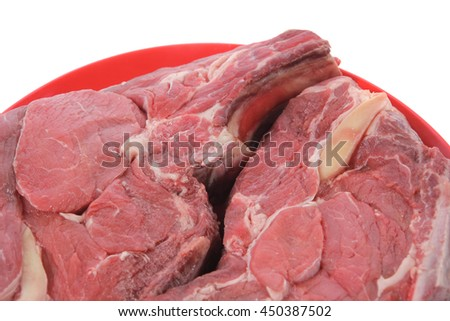 two fresh raw red ribeye beef steak on red plate isolated over white background rib eye - stock photo