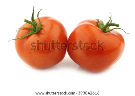 two fresh tomatoes on a white background - stock photo