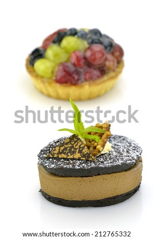 Two fresh yummy cakes on white background - stock photo