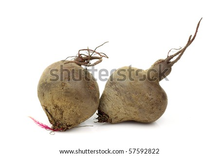 two freshly harvested beetroots on a white background
