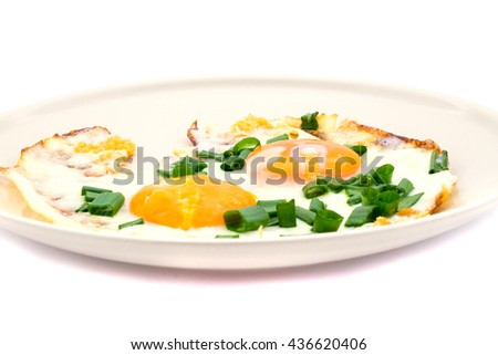 Two fried eggs with chives for healthy breakfast. - stock photo