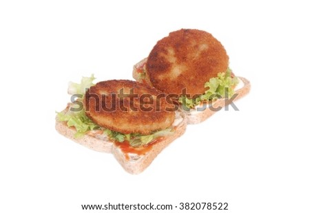 Two fried hamburger beef patties with lettuce, tomato sauce and mayonnaise on toast. Image isolated on white studio background. - stock photo