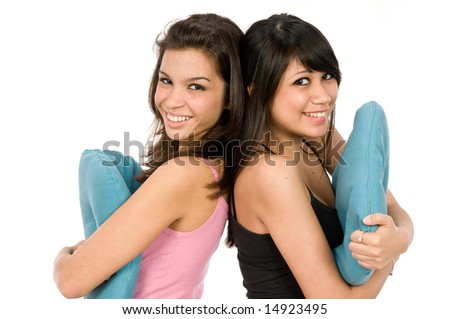 Two friends dressed in pyjamas together - stock photo