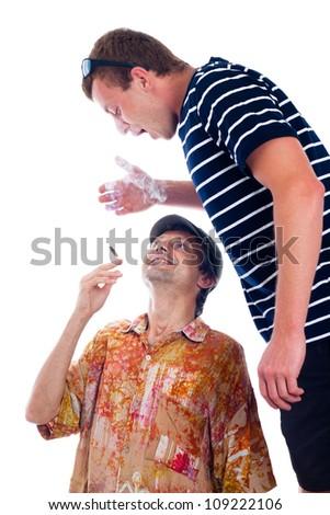 Two friends enjoy smoking hashish joint, isolated on white background. - stock photo