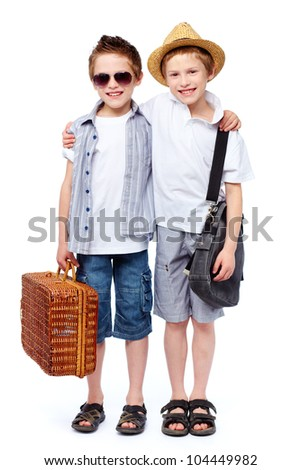 Two friends going for a picnic, isolated against white background - stock photo