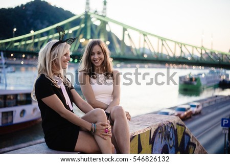Two friends having fun in city