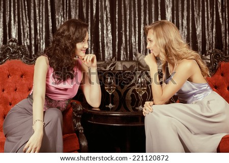 Two friends having fun in the restaurant - stock photo