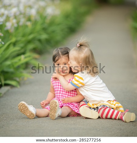 two friends hug each other - stock photo