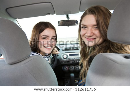 two friends in car who is happy to have is new car - stock photo