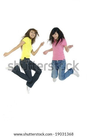 Two friends jumping - stock photo