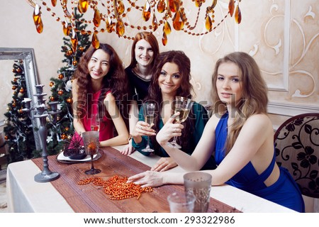 Two friends on a party, girl sitting at the holiday table - stock photo