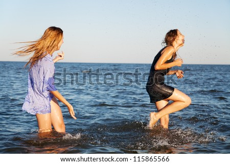 Two friends on a sea beach - stock photo