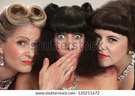 Two friends on either side of friend with frizzy hair - stock photo