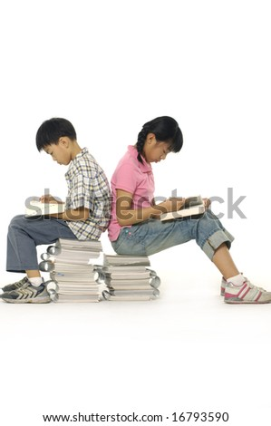 Two friends reading a book - stock photo