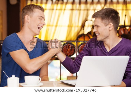 two friends shaking each other Guy Friends Talking To Each Other