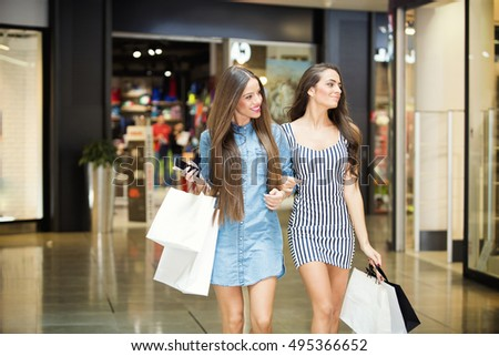 Two friends shopping at the mall