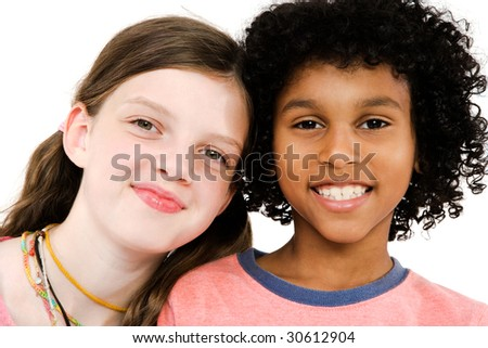Two friends smiling isolated over white - stock photo