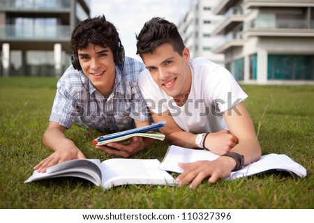Two friends studying at the park - stock photo