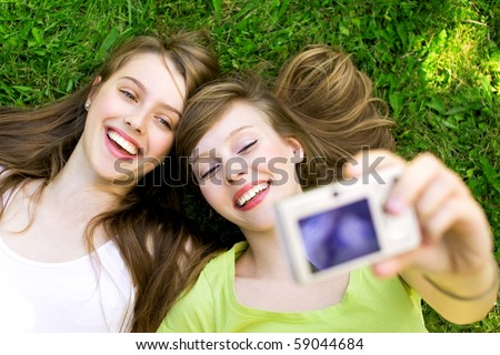 Two friends taking pictures - stock photo