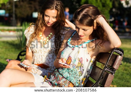 Two friends taking selfie by smartphone - stock photo