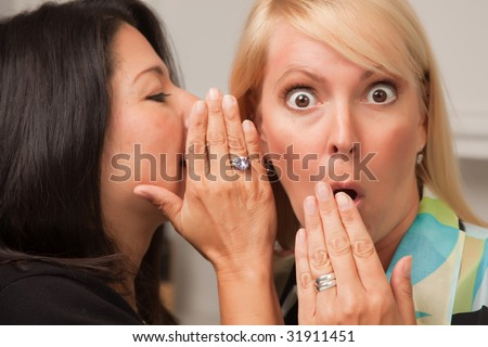 Two Friends Whispering Secrets in the Ear. - stock photo