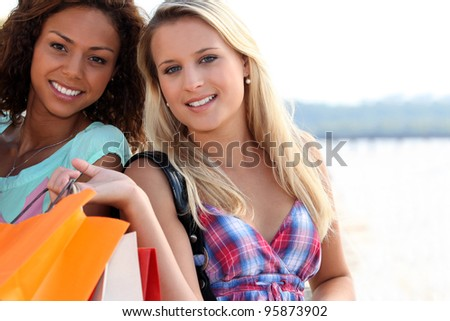 Two friends with shopping bags - stock photo