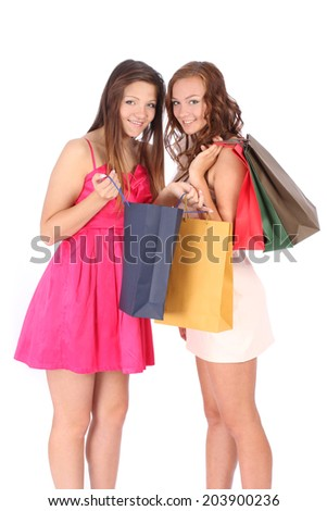 Two friends with shopping bags on a white background - stock photo