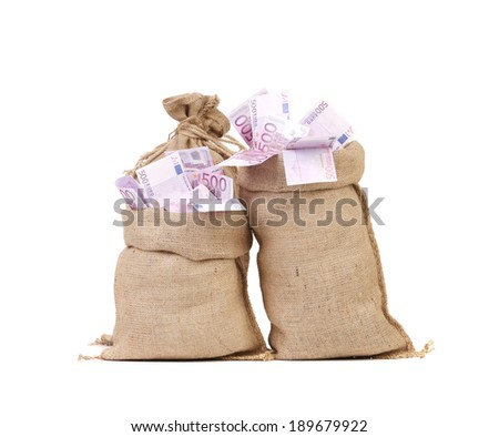 Two full bags with euro banknotes. Isolated on a white background. - stock photo