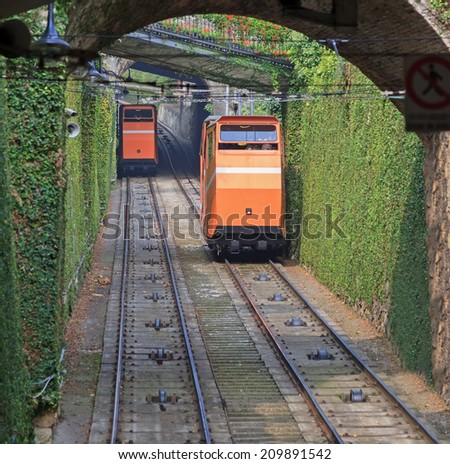Two funiculars moving on the railroad in Bergamo, Italy