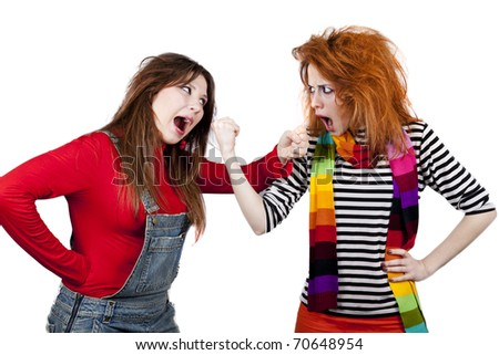 Two funny angry girls. Studio shot. - stock photo