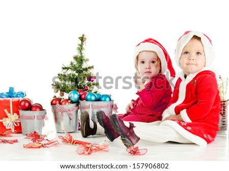 two funny baby girl santas