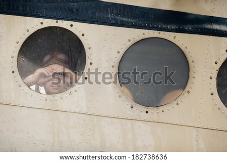 two funny boys in window of plane - stock photo
