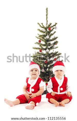 two funny boys with santa costumes - stock photo