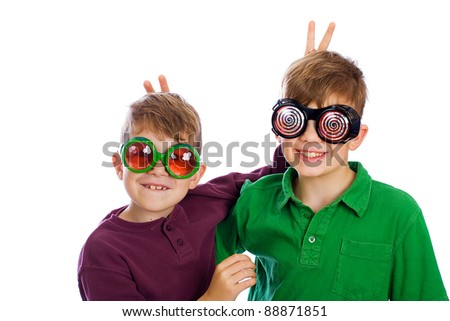 Two funny boys with silly glasses on. - stock photo