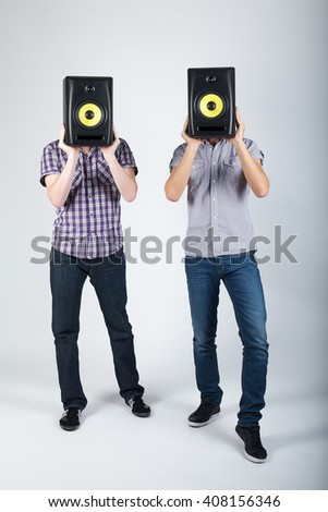 two funny boys with speakers