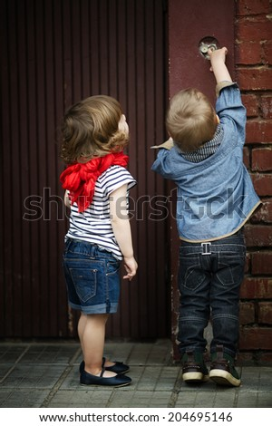 two funny children play with intercom - stock photo
