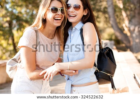 Two funny girls laugh. Park. - stock photo