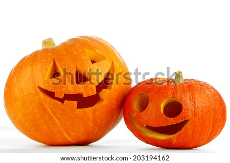 Two funny Jack O Lantern halloween pumpkins isolated on white background - stock photo