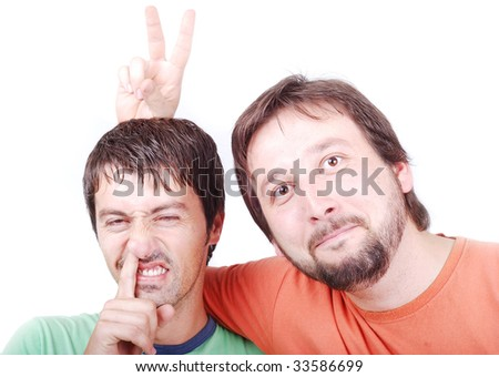 Two funny men are laughing and showing signs