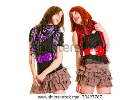 Two funny teengirls showing  tongues isolated on white - stock photo