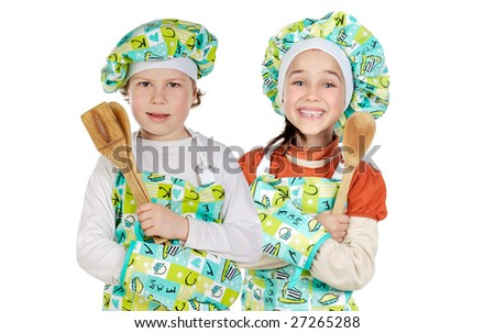 Two future cooks with hat and apron isolated over white - stock photo