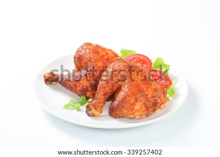 Two garlic roasted chicken leg quarters on plate