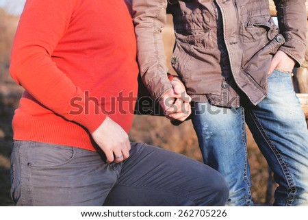 Two gay man holding hands - stock photo