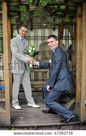 two gay men in garden house - stock photo