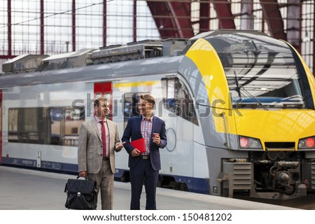 Two generation of Businessmen talking - stock photo