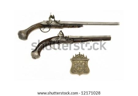 Two genuine old hand guns - stock photo