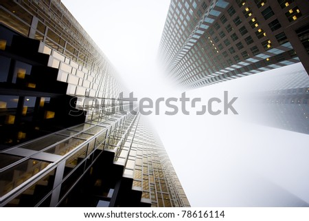 Two giant skyscrapers looking as if they are fighting each other - stock photo