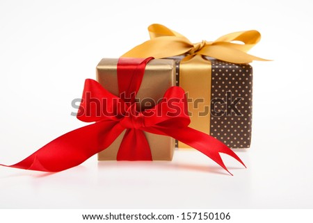 Two gift box, Gold and brown with red and gold ribbon